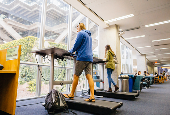Students using treadmill desks