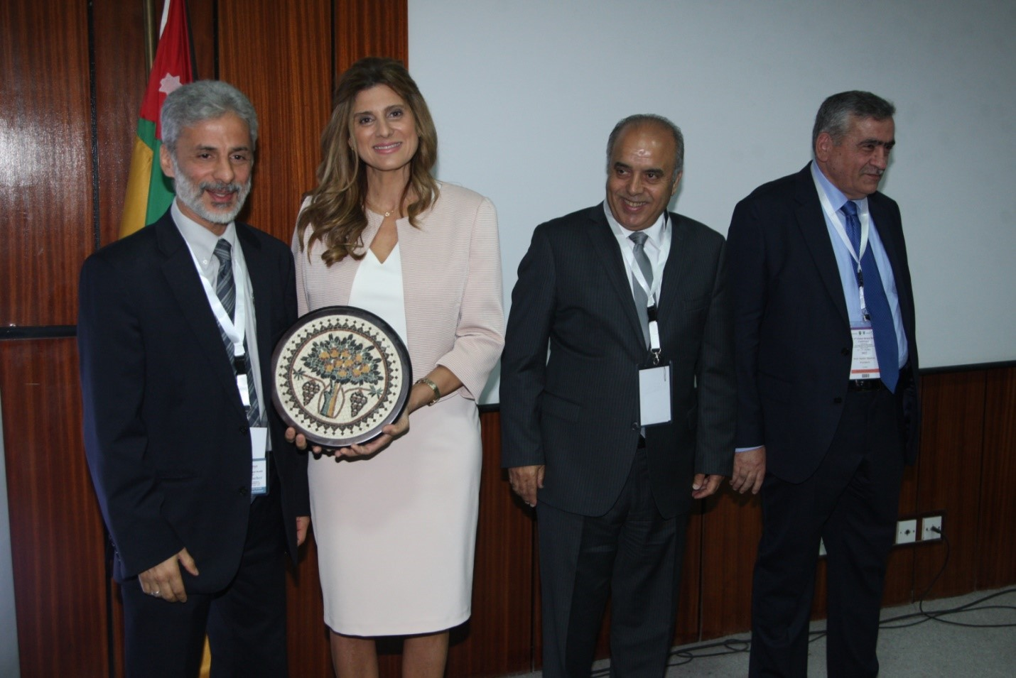 Her Highness Princesses Dina Mired of Jordan, the Conference Patron, awards Dr. Al-Delaimy the Conference plaque for his effort in co-leading the organization of the 2017 2nd National Global Mental Health Conference to the left of her is President of the University of Jordan and the Dean of School of Medicine.